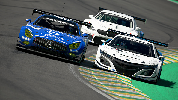 SAO PAULO, BRAZIL - MAY 31: (Editors note: This image was computer generated in-game) Valerio Gallo (Williams_BRacer26) of Italy and Honda battles with Baptiste Beauvois (Veloce_TSUTSU) of France and Mercedes during the Manufacturer Series Top 16 Superstars Round 3 of the FIA Gran Turismo Championship 2020 at Autodromo Jose Carlos Pace on May 31, 2020 in Sao Paulo, Brazil. (NOTE TO USER - Gran Turismo Sport: TM & © 2017 Sony Interactive Entertainment Inc. Developed by Polyphony Digital Inc. Manufacturers, cars, names, brands and associated imagery featured in this game in some cases include trademarks and/or copyrighted materials of their respective owners. All rights reserved). (Photo by Clive Rose - Gran Turismo/Gran Turismo via Getty Images)